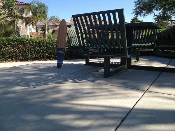 Longboard against table by RyanAvelino