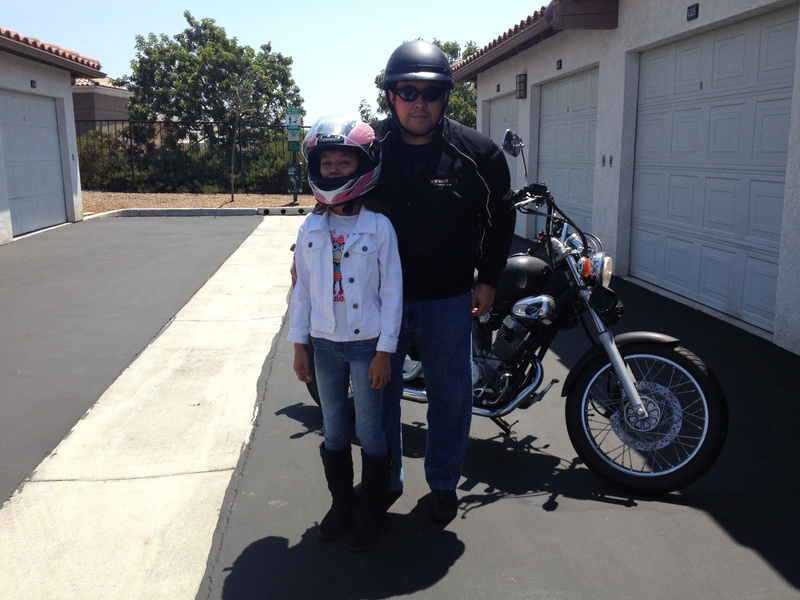My Sister going on a ride with Dad