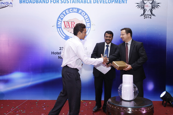 deepak-sahu-ajay-kaul-with-the-lucky-draw-winner-at-12th-varindia-it-forum-2014 by Varindia
