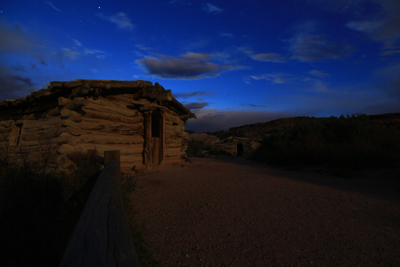full moon on old cabins