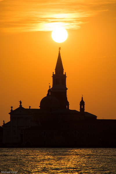 Campanile of San Giorgio Maggiore scratches the Venice morning sun.