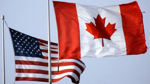 2008_0923_us_canada_flags_b_m by BerardiImmigrationlaw