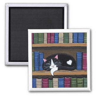 tuxedo_cat_sleeping_on_bookshelf_cat_art_magnet-r86c86023...