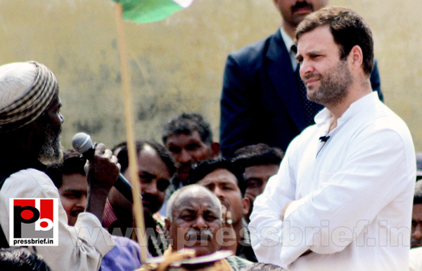 Rahul Gandhi interacts with rickshaw pullers by...