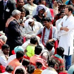 Rahul Gandhi interacts with rickshaw pullers