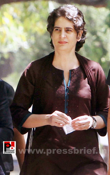 Priyanka Gandhi Vadra interacts with an elderly woman...