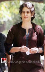 Priyanka Gandhi Vadra interacts with an elderly woman before casting her vote for Lok Sabha election