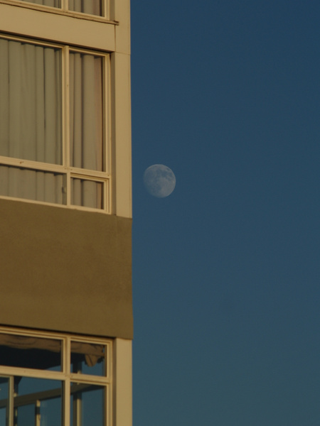 Man on a ledge or man on the moon by EstebanAguilar