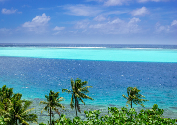 Bkue water of Huahine by SandyBrinsdon