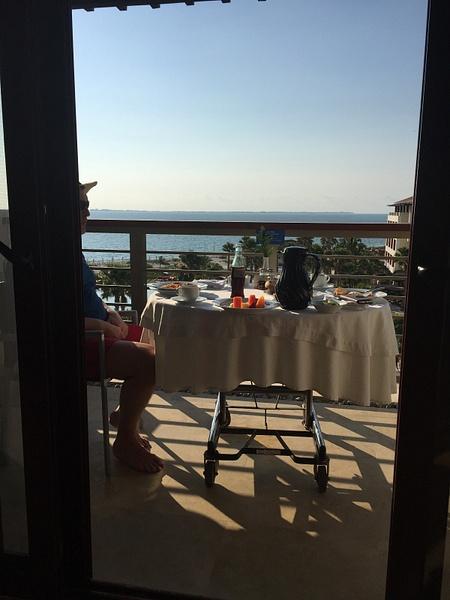 Breakfast on the balcony by JanieBac