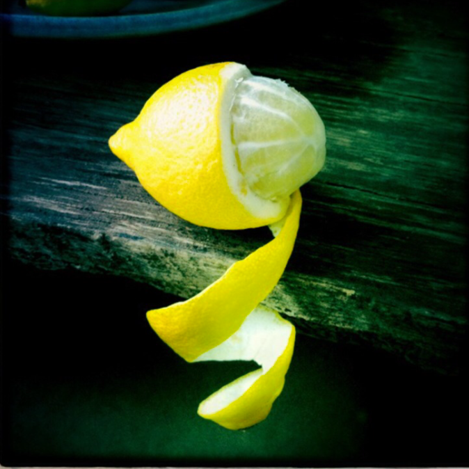 peeling a lemon during lunch break