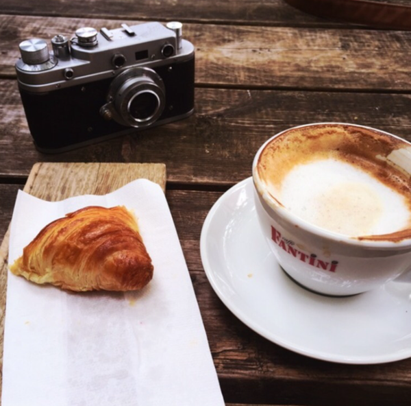 french croissant and coffee by Gabriel le Roux