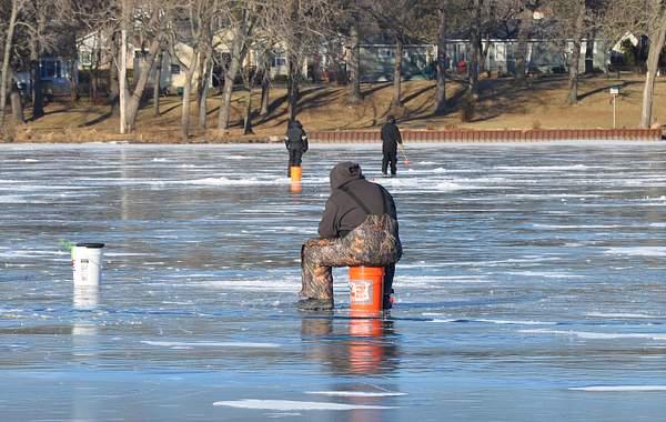 Winter Ritual, a portrait of ice fisherman.