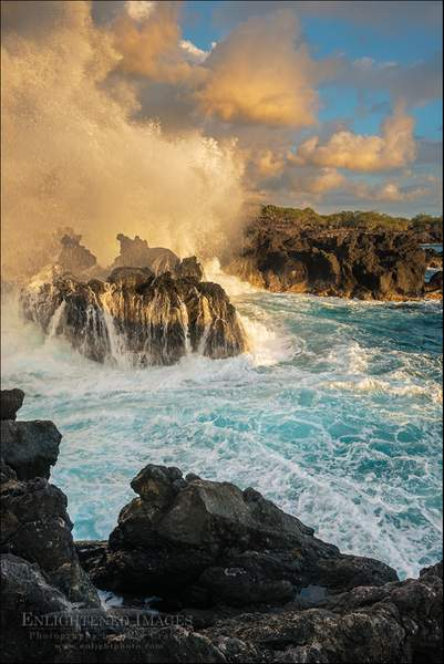 Waves crashing against coastal lava rocks at sunset at The End of the World