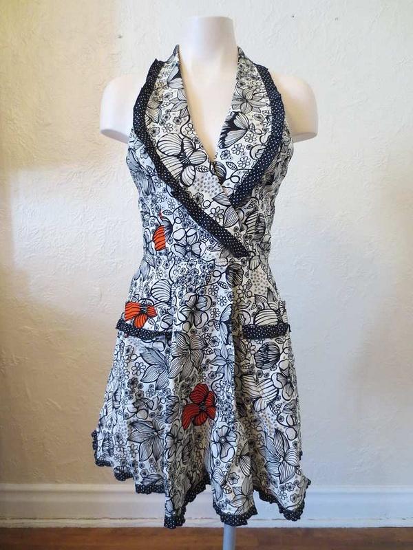 R-09 Robe tablier neuve (taille unique) 45 $