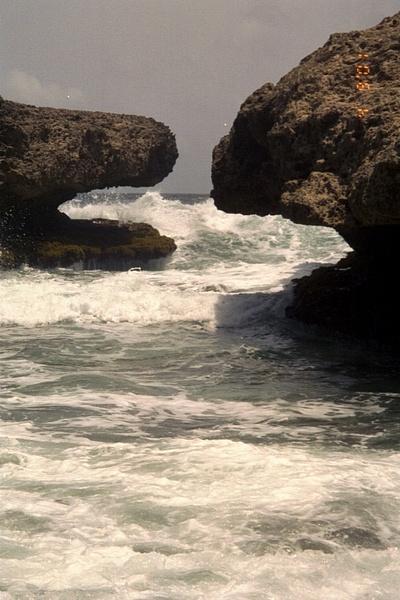 Waves crashing through the rocks by Vernon Adams