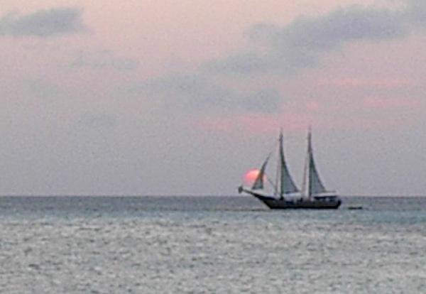 Schooner at sunset by Vernon Adams