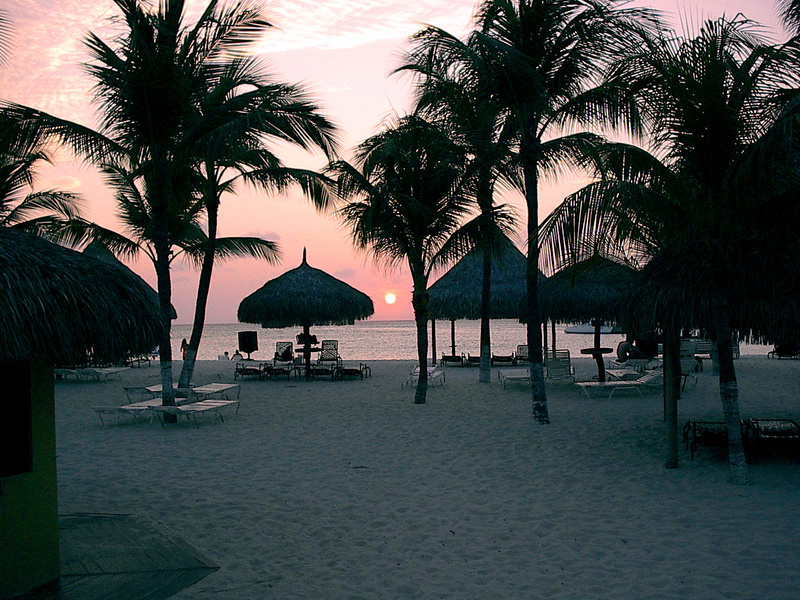 Sunset behind the huts