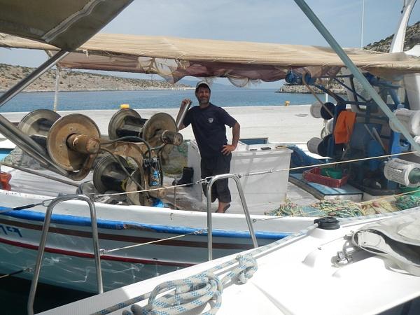 Our friendly Greek fisherman by Vernon Adams