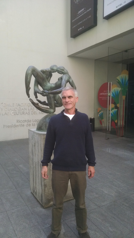 In front of sculpture