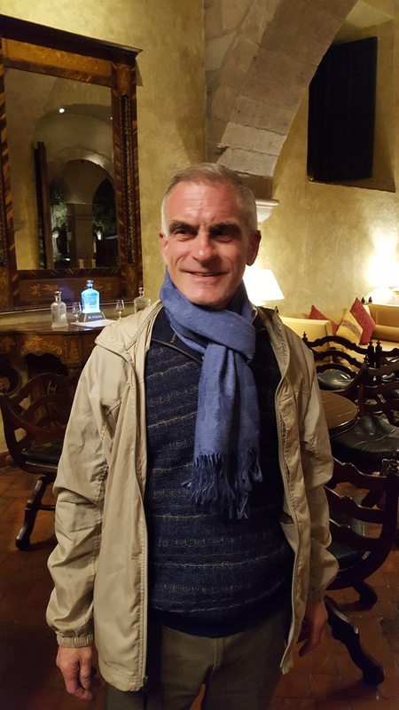 With New scarf and sweater in Cusco, Peru