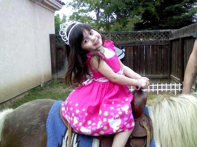 MIa on a pony