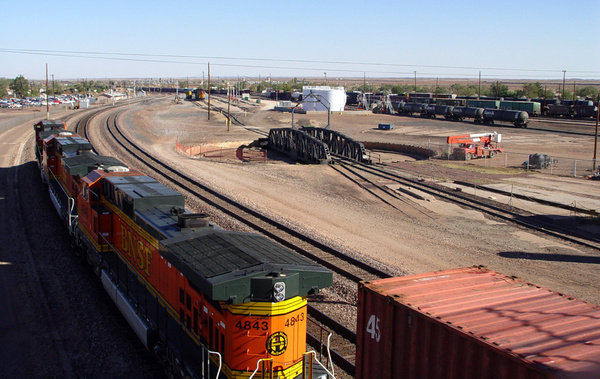 Eastbound freight slowing for yard by ArizonaLorne