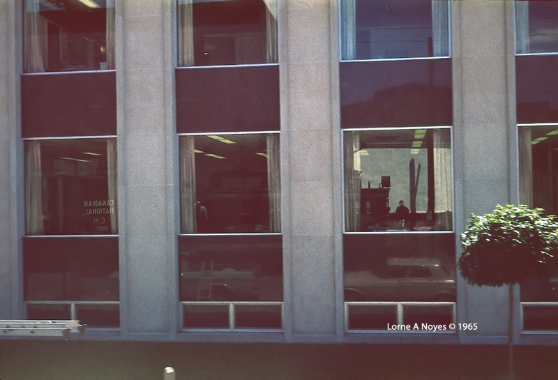 Shooting my reflection in a passing building