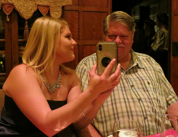 Granddaughter Shyanne showing photo to Grandpa Bergeron...