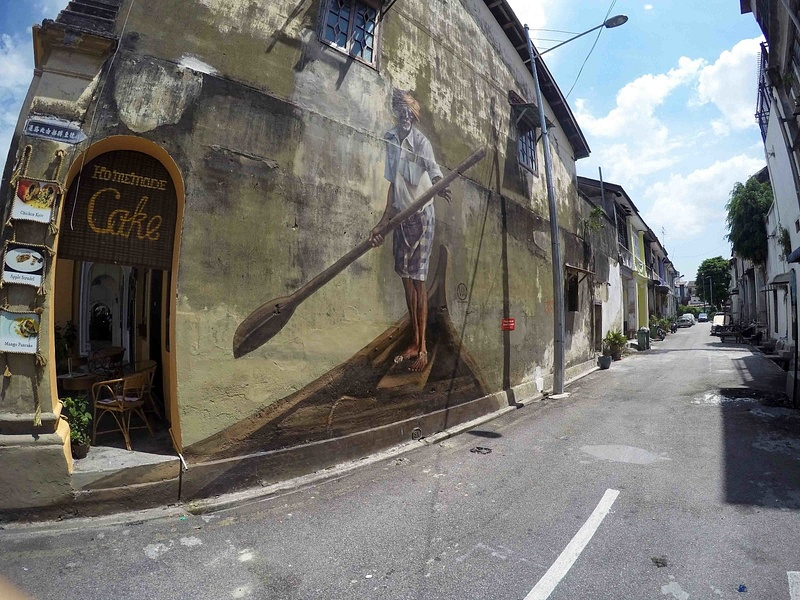 travel-street-art-penang-man-driving-by