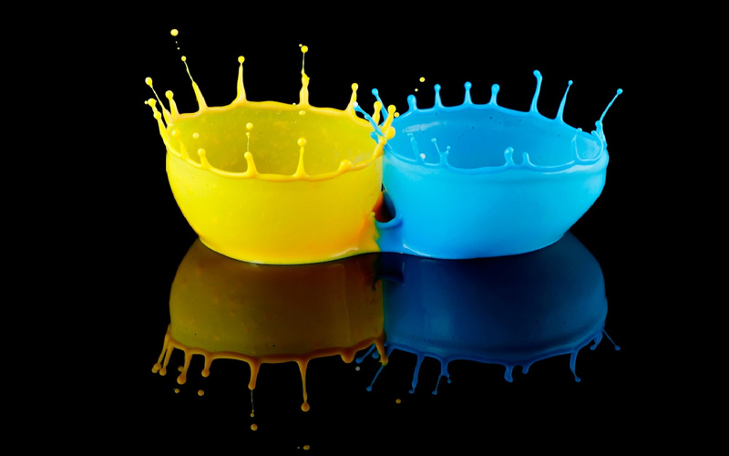 Yellow-and-blue-colors-splash-in-black