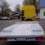 Jármű-munkagép szállító