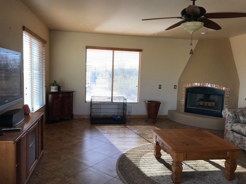 MORE FAMILY ROOM WITH KIVA FIREPLACE