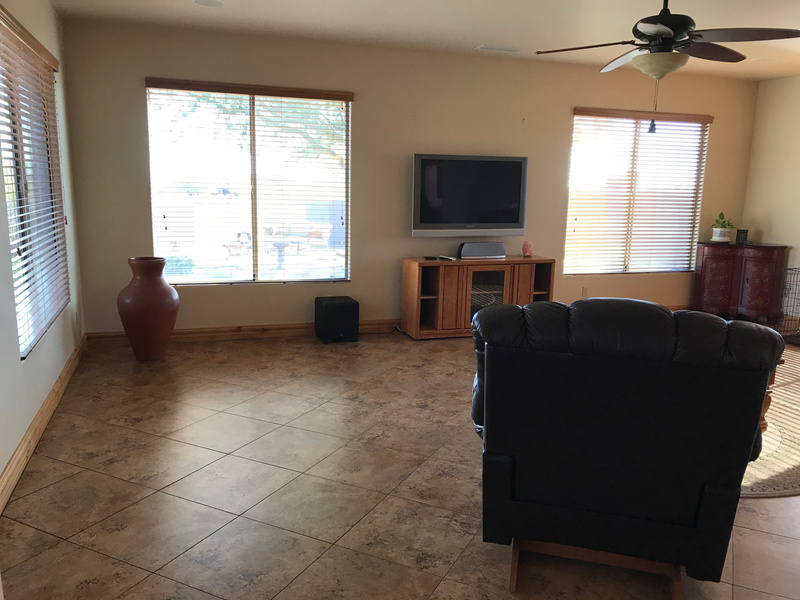 FAMILY ROOM LOOKING TO BACK AND SIDE YARD
