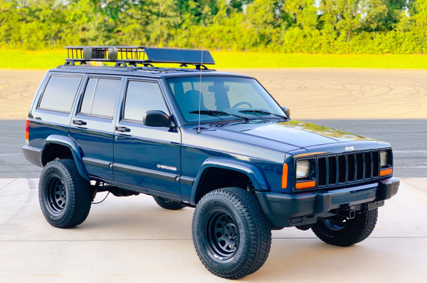 Blue lifted cherokee by autosales by autosales