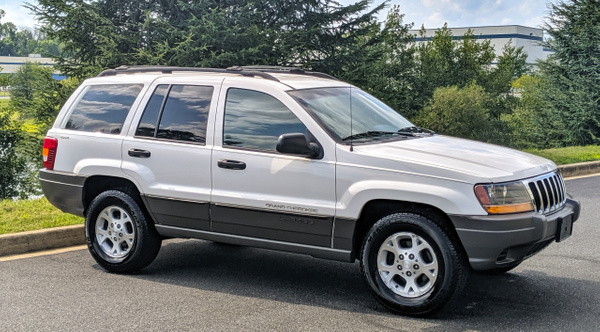 WHITE GRAND CHEROKEE by autosales by autosales