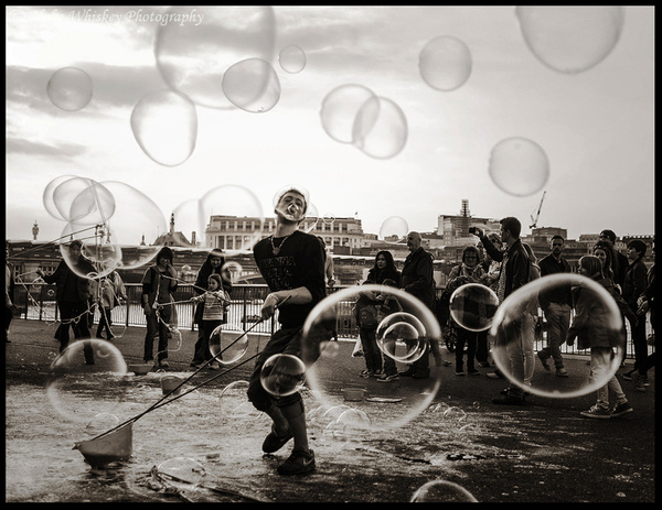 Blowing Bubbles by Alpha Whiskey Photography