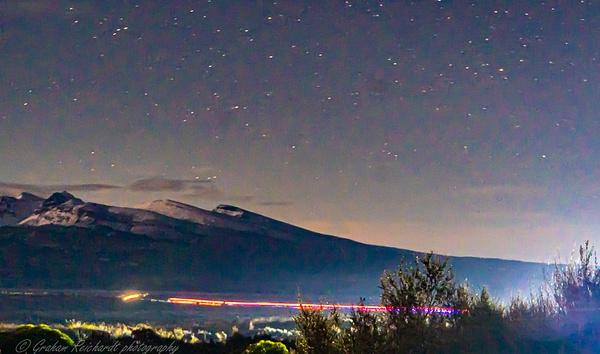 night sky and truck lights taken on Desert RD - Night Sky - Graham Reichardt Photography