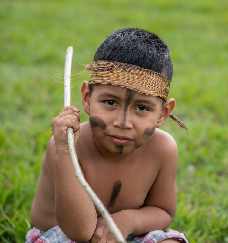 Young boy in traditional paint