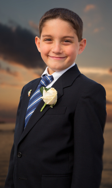 young_man_port_jefferson_flower_blue_white_tie_dark_suite_sunset - Portraits - Matt West Photography