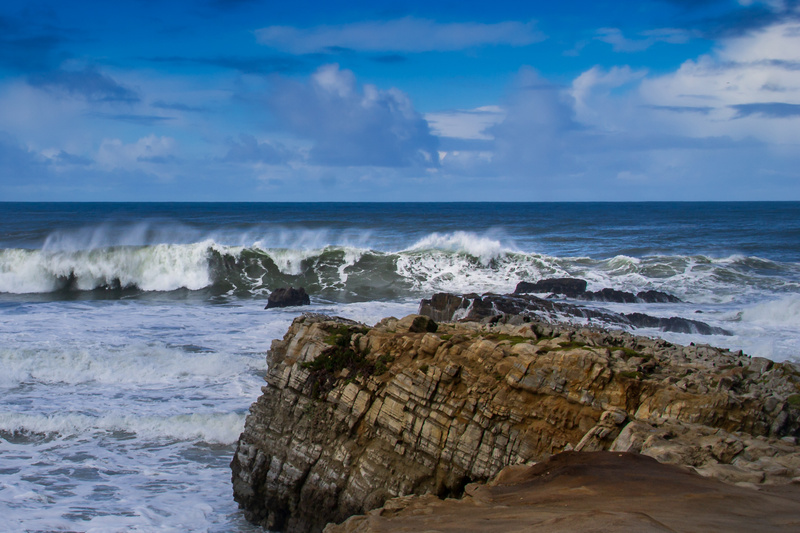 Rocks, waves, spindrift, clouds