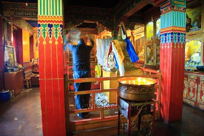 Buddhist Monk doing morning prayers