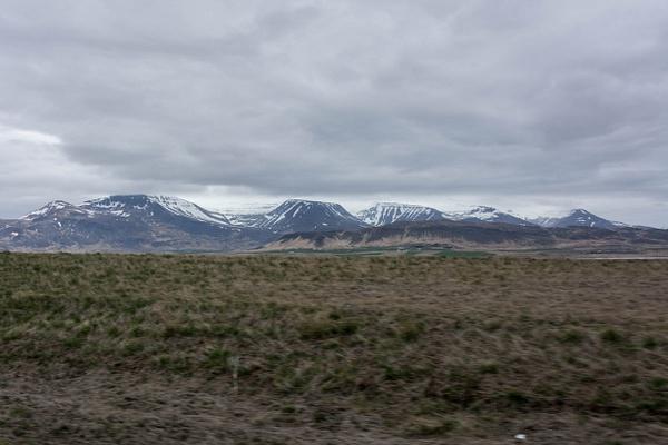 Majestic peaks between Grundartangi and Borganes by...