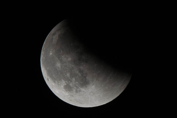 Moon half uncovered, 2200MDT by Willis Chung