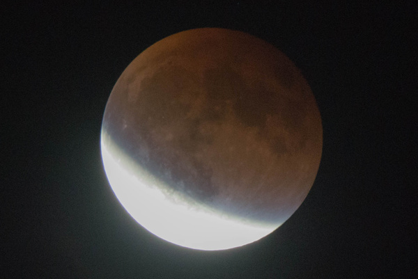 Eclipsed portion of the moon, 2140MDT by Willis Chung