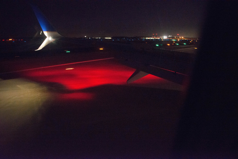 Runway lit by the light of the anti-collision beacon