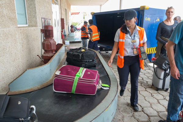 Our luggage is fully unloaded and scanned before any of...