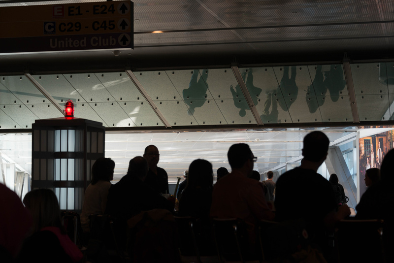 Interesting reflections of travellers in overhead glass at Houston airport
