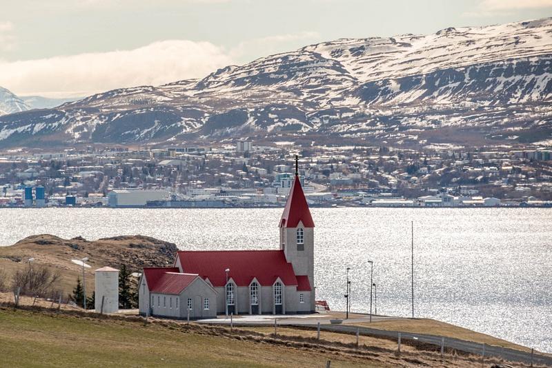 Svalbarðskirkja with Akureyri across the fjord