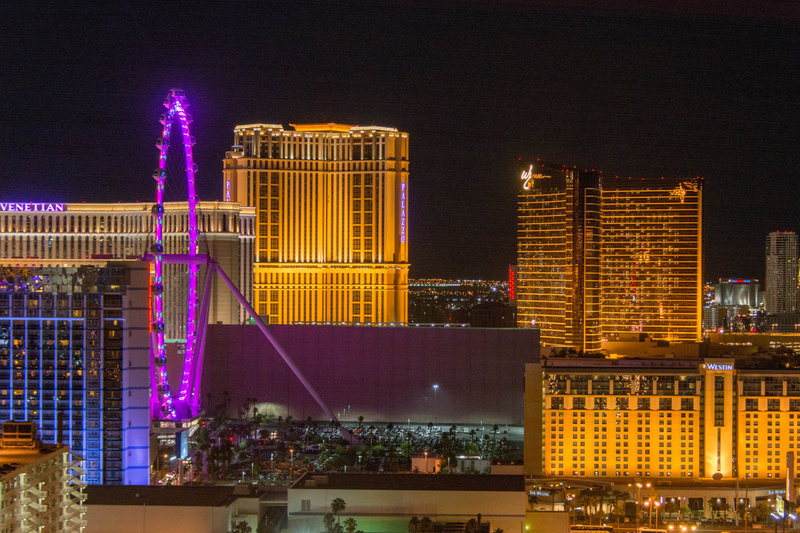 High Roller with many casinos as a backdrop